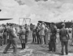 Claire Chennault with Chinese officers at an airfield, Kunming, Yunnan Province, China, 1942-1943; note P-38 fighter