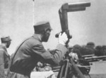 Chiang Kaishek observing an artillery exercise, date unknown