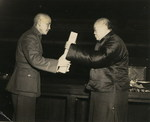 Chairman of the Chinese National Assembly Woo Tsin-hang ceremonially delivered a copy of the Constitution of the Republic of China to Chiang Kaishek, 25 Dec 1946