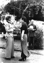 Song Meiling welcoming journalist Clare Boothe Luce, Maymyo, Burma, 19 Apr 1942; Chiang Kaishek in background