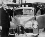 Prime Minister Ben Chifley at the launching of the first mass-produced Australian car at the General Motors-Holden factory, Fisherman