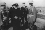 Winston Churchill visiting US Marines on Iceland, 16 Aug 1941; note Ensign Franklin Roosevelt, Jr. and Lieutenant Colonel Oliver Smith also present