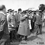 Winston Churchill took aim with a Sten gun during a visit to the Royal Artillery experimental station at Shoeburyness in Essex, England, United Kingdom, 13 Jun 1941