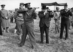 Major General Edward Brooks (behind Eisenhower) demonstrating M1 Carbines to Dwight Eisenhower, Winston Churchill, and Omar Bradley, England, United Kingdom, 15 May 1944, photo 2 of 2