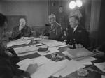 Winston Churchill, Archibald Wavell, and James Somerville in conference aboard the ship Queen Mary, May 1943