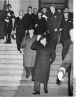 Prime Minister Chamberlain, Prime Minister Daladier, and Ambassador Francois-Poncet departing from Munich Conference after the agreement was reached, Germany, 29 Sep 1938