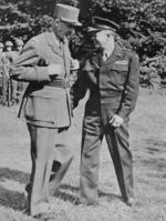 General Charles de Gaulle talking with General Dwight Eisenhower during an inspection of US troops at Eisenhower