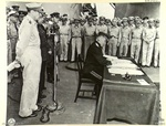 General Kuzma Nikolaivich Derevyenko signing the surrender instrument on behalf of the Soviet Union aboard USS Missouri, Tokyo Bay, Japan, 2 Sep 1945, photo 1 of 2