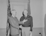 US President Harry Truman awarding General Dwight Eisenhower the third Oak Leaf Cluster to the Distinguished Service Medal, Pentagon, Virginia, United States, 7 Feb 1948, photo 1 of 2