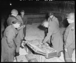 US Generals Eisenhower and Bradley examining a suitcase of German loot stored in the Merkers salt mine, Germany, 12 Apr 1945