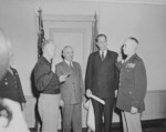 General Dwight Eisenhower swearing General Omar Bradley into office as Chief of Staff of the US Army, Pentagon, Arlington, Virginia, United States, 7 Feb 1948, photo 1 of 3; note US President Harry Truman and Secretary of Army Kenneth Royall in background