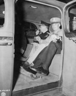 William Leahy, Dwight Eisenhower, and Harold Stark in a car, Antwerp, Belgium, 16 Jul 1945