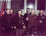 Generals Susloparov, Morgan, Smith, Eisenhower, Air Chief Marshal Tedder after signing of German surrender documents, Rheims, France, 7 May 1945, photo 2 of 3; note Eisenhower holding pens used