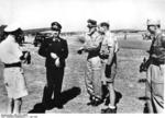 German Luftwaffe Lieutenant General Theodor Osterkamp, Major General Adolf Galland, Colonel Günther Lützow, and Lieutenant Colonel Günther von Maltzahn on an airfield in Italy, 3 Jul 1943