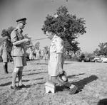 King George VI of the United Kingdom knighting Oliver Leese in the field, Italy, 26 Jul 1944