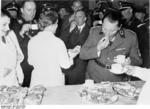 Göring trying a dish made by a German housewife during an event celebrating homemakers, Berlin, Germany, 29 Jan 1937