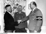 Greiser shaking hands with the one millionth German resettler of Wartheland, Posen, Germany, 16 Mar 1944