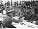 Hitler having a meal with German Army officers on the side of the road between Franzensbad and Eger, Sudetenland, Germany, 3 Oct 1938