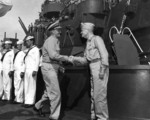 Fleet Admiral Nimitz and Admiral Halsey shaking hands aboard battleship USS South Dakota, Tokyo Bay, Japan, 29 Aug 1945