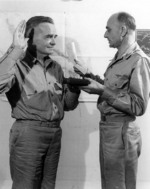 US Navy Admiral William Halsey being sworn in as Commander, South Pacific Force, by his Chief of Staff Captain Miles Browning, 27 Nov 1942