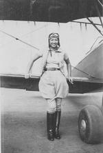 Hazel Lee posing with a biplane, circa 1930s