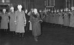 Former President Kyösti Kallio of Finland (resigned) and Field Marshal C.G.E. Mannerheim at Helsinki railway station, Finland, 19 Dec 1940; Pres Ryti, Lt Gen Heindrichs, and Col Paasonen in background