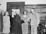 Chief Justice of Victoria, Australia Edmund Herring shaking hands with Major General C. E. M. Lloyd, Melbourne, Australia, 2 Feb 1944