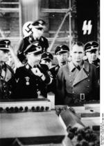SS-Reichsführer Heinrich Himmler and Rudolf Heß viewing a model of the Dachau Concentration Camp, Dachau, Germany, 8 May 1936
