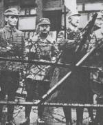 Heinrich Himmler (holding flag) outside the office of the Military District for Bayern (Bavaria) during the Beer Hall Putsch, München (Munich), Germany, 9 Nov 1923