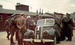 Heinrich Himmler in passenger seat of a sedan in the ghetto of Litzmannstadt/Lodz, Poland, Jun 1941; the white-haired civilian next to the vehicle was Chaim Rumkowski, chairman of the Jewish Council