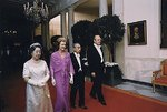 Empress Kojun, First Lady Betty Ford, Emperor Showa, and President Gerald Ford walking toward the East Room of the White House, Washington DC, US, 2 Oct 1975, photo 2 of 2