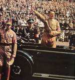 Adolf Hitler saluting a crowd, late 1930s
