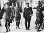 Chancellor Hitler, General Witzleben of German III Corps, and SS-Obergruppenführer Dietrich leaving the 300m freestyle swimming event of the 1936 Summer Olympic Games, Berlin, Germany, 5 Aug 1936