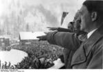 Chancellor Hitler saluting the athletes from balcony of the Olympic House during opening ceremony of the IV Olympic Winter Games, Garmisch-Partenkirchen, Bavaria, Germany, 6 Feb 1936, photo 2 of 4