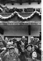 Chancellor Hitler saluting the athletes from balcony of the Olympic House during opening ceremony of the IV Olympic Winter Games, Garmisch-Partenkirchen, Bavaria, Germany, 6 Feb 1936, photo 3 of 4