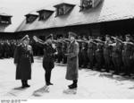 Hitler visiting the Ordensburg Vogelsang school in North Rhine-Westphalia, Germany, 29 Apr 1937, photo 1 of 2; Dr. Robert Ley seen with Hitler