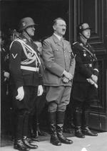 Josef Dietrich, Adolf Hitler, and Heinrich Himmler at the entrance of the Chancellery in Berlin, Germany, 20 Apr 1937 during a celebration for Hitler