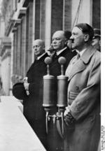 Hitler speaking to 15,000 rail workers from balcony of Reich Chancellery, 4 Feb 1937; Government Secretary Hans-Heinrich Lammers and Minister of Transport Julius Heinrich Dorpmüller next to Hitler