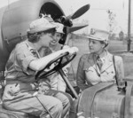 Colonel Oveta Hobby (right) speaking with Auxiliary Margaret Peterson and Captain Elizabeth Gilbert at Mitchel Field, New York, United States, 1943