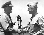 Smith was congratulated by Nimitz after being decorated with a Gold Star in lieu of a second Distinguished Service Medal, date and location unknown
