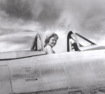 Celia Hunter in the cockpit of a P-47 fighter, date unknown