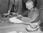 Wilhelm Keitel signing surrender documents at the Soviet headquarters near Berlin, Germany, 8 May 1945