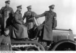 Keitel, Hitler, and Speer observing the field during a weapons demonstration, circa 6 Apr 1943