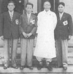 Kim Gu with Korean Boston Marathon participants, 1947; note Suh Yunbok, winner of the marathon, next to Kim