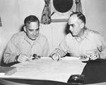 Barbey and Kinkaid over a map of New Guinea, 5 Jan 1944