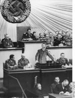 Adolf Hitler giving a speech to the Reichstag, Kroll Opera House, Berlin, Germany, 6 Oct 1939; also present: Göring, Heß, Ribbentrop, Raeder, Frick, Goebbels, Neurath, Frank, Lammers, Seyß-Inquart, Keitel