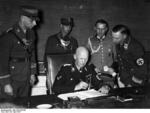 German State Secretary Hans Lammers at his desk with his adjutants, Berlin, Germany, 29 Apr 1937