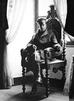 US Army Brigadier General Douglas MacArthur sitting in a chair in St. Benoit Chateau, France, 19 Sep 1918
