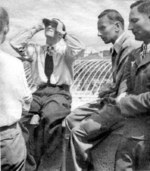 Hans-Joachim Marseille observing the flight of a new Bf 109 fighter, Augsburg, Germany, Jul 1942