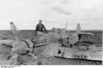 Hans-Joachim Marseille with a British Hurricane fighter that he had shot down, Libya, Mar 1942, photo 1 of 3
